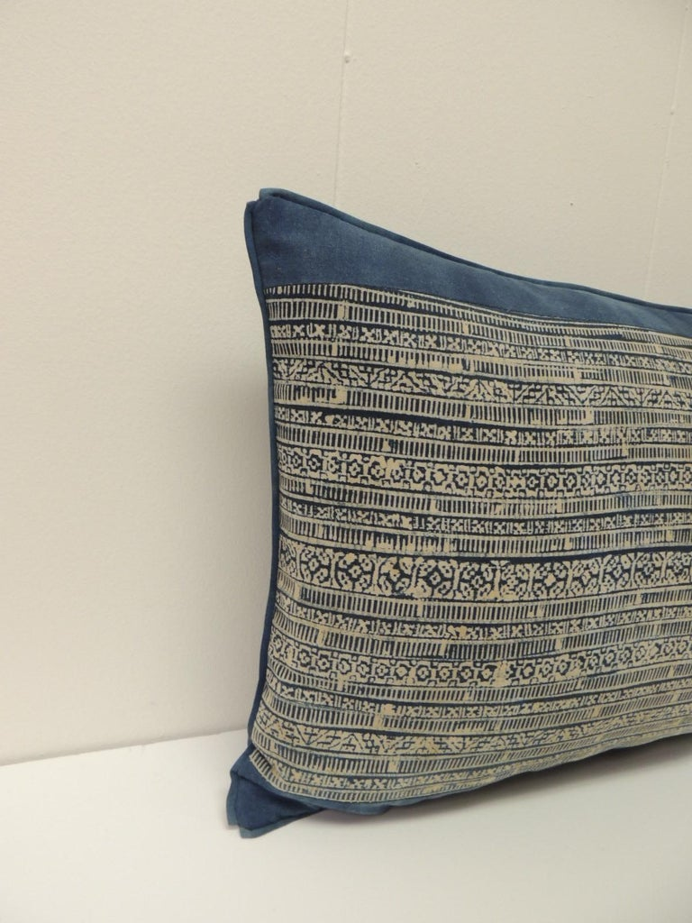 Vintage blue and natural hand-blocked tribal batik Lumbar decorative pillow, framed with same cotton textile and custom ATG blue flat trim. Backed with slate blue woven linen. Decorative pillow handcrafted and designed in the USA. Closure by