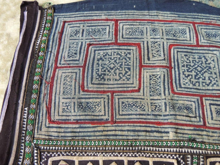 Vintage blue and red Miao embroidered textile fragment.
