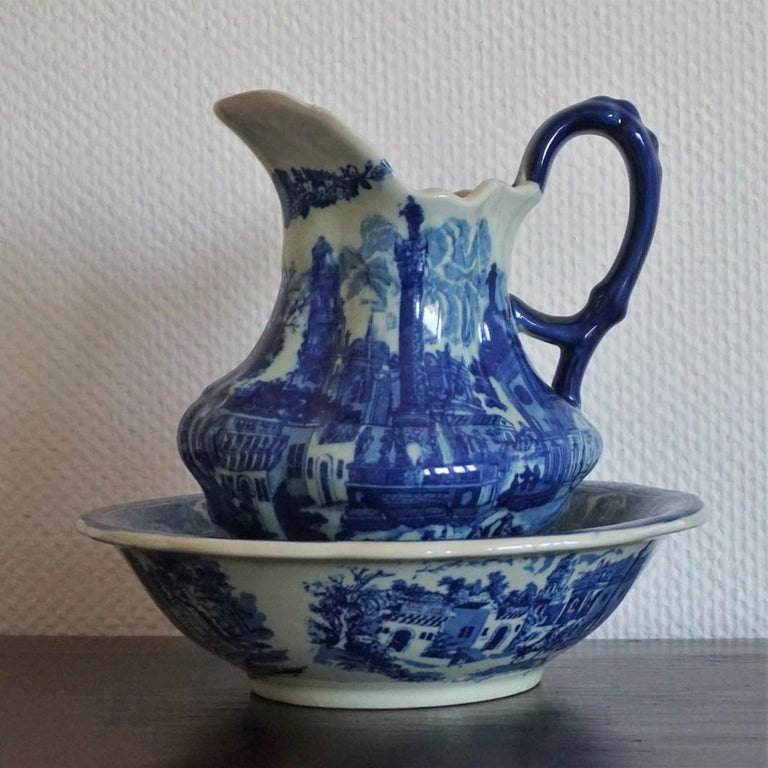 Large Vintage blue and white ceramic wash bowl and water pitcher richly decorated with beautiful motivs, circa 1970 - 1980.  In very good condition, colour very well preserved, no chips or cracks. Dimensions: Pitcher: Width 10