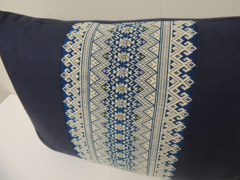 Vintage Asian embroidered decorative bolster pillows, pair of pillows with an intricate woven silk-on-silk centered trim framed with royal blue textured linen. The same textured royal blue linen in the front was used to finish the back of the accent