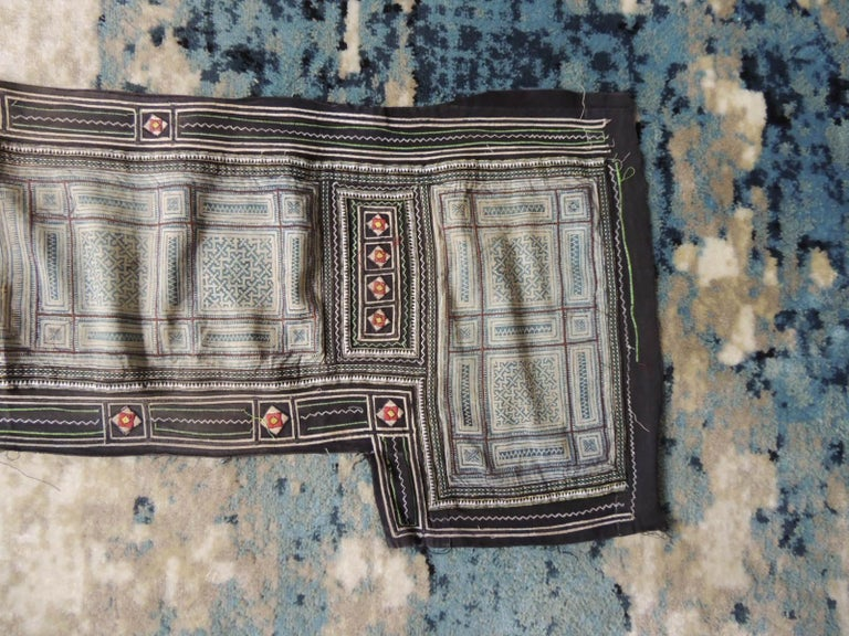 Vintage blue and white Miao Embroidered textile panel. Chinese textile with metallic gold threads embroidery in shades of black, blue, gold, yellow, red, white and black. Size: 14.5