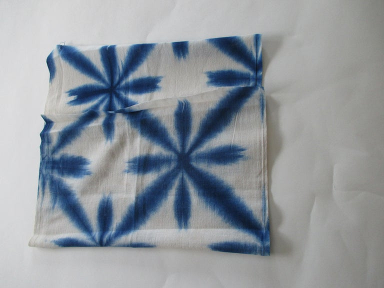 Vintage blue and white shibori textile fragment. The word comes from the verb root shiboru,
