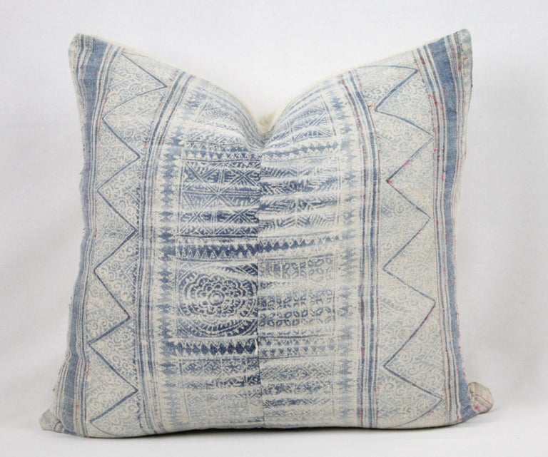 Vintage blue batik style pillow with zipper closure. Back is in antique French linen. Main colors are off-white with a medium blue, light blue color, with red thread running through the design. Does not include insert. Measures: 20