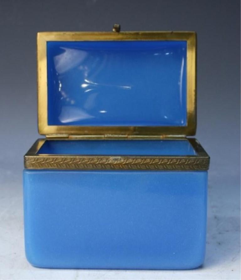 Vintage 20th century blue opaline glass vanity box with brass setting; unmarked. Hinge in good working order and good condition interior.