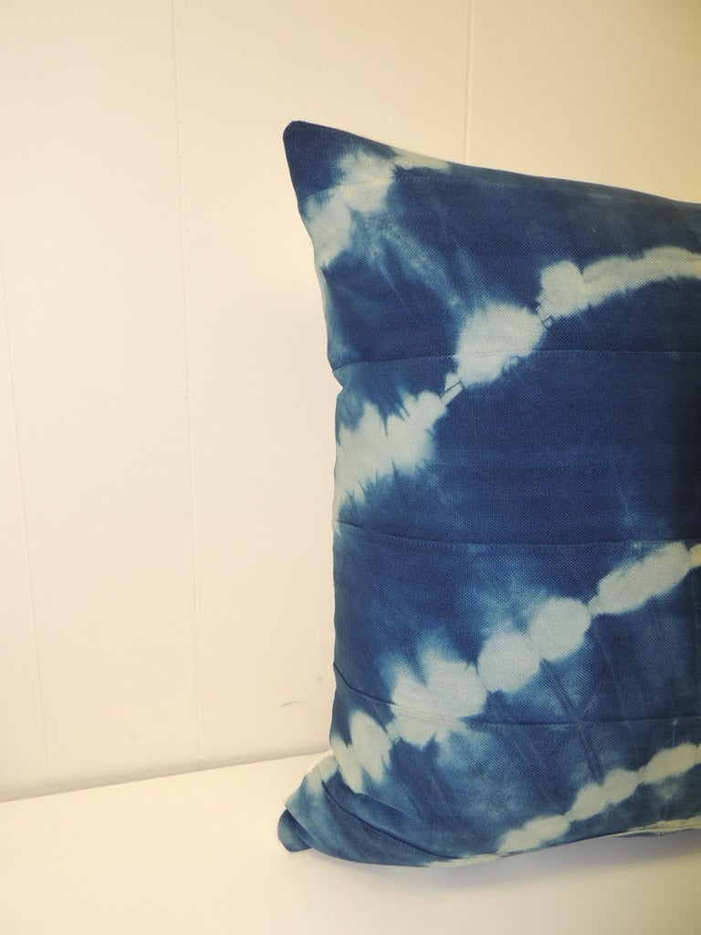 Vintage Indigo and White African Resist-dye Textile Decorative Pillow Sunburst pattern square pillow with textured white silk backing. Decorative pillow hand-made and designed in the USA.  Closure by stitch (no zipper) with custom made feather/down
