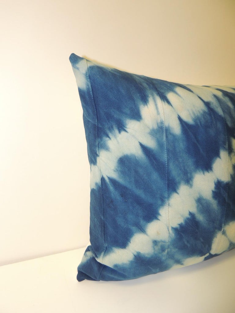 Vintage indigo blue and white African hand dyed textile decorative bolster pillow. Sunburst pattern square pillow with textured white silk backing. Decorative pillow handmade and designed in the USA. Closure by stitch (no zipper) with custom made