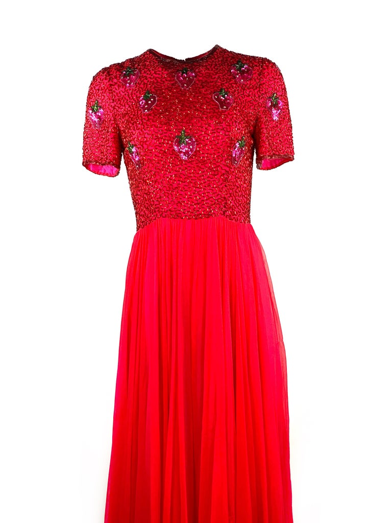 "Vintage BOB MACKIE Red and Pink Strawberry Maxi Evening Dress Gown Size 10  Product details: Size 10 Short sleeves, measure 8.75"" from the shoulder Featuring sequin strawberry pattern detail Rear zip and hook closure Made in USA"