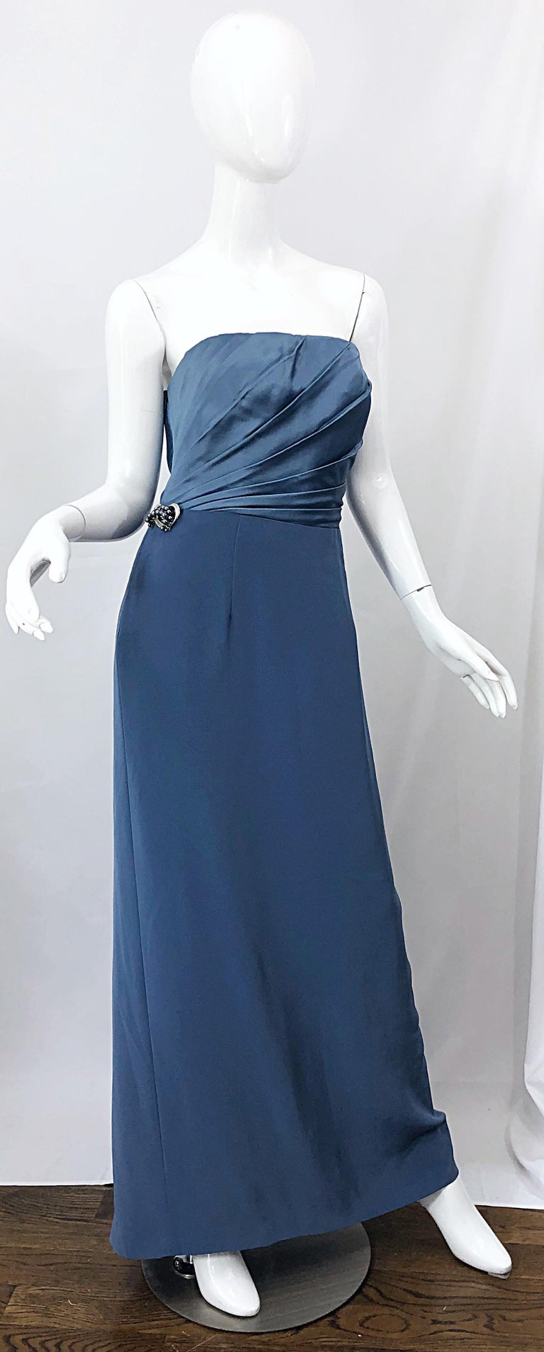 Incredible vintage 1980s BOB MACKIE blue Size 12 strapless silk crepe gown! This dress is spectacular in person! Super flattering, and the perfect shade of blue. Fully lined. Hidden zipper up the side with  hook-and-eye closure. Attached pearl,