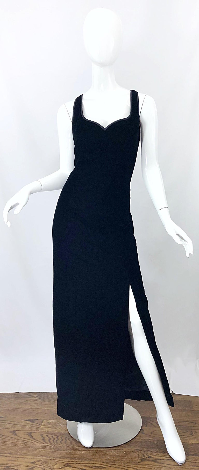Beautiful vintage 90s BOB MACKIE black velvet sleeveless evening gown! Features a flattering satin lined sweetheart neckline and a thigh high slit that reveals just the right amount of leg. Hidden zipper up the back with hook-and-eye closure. The