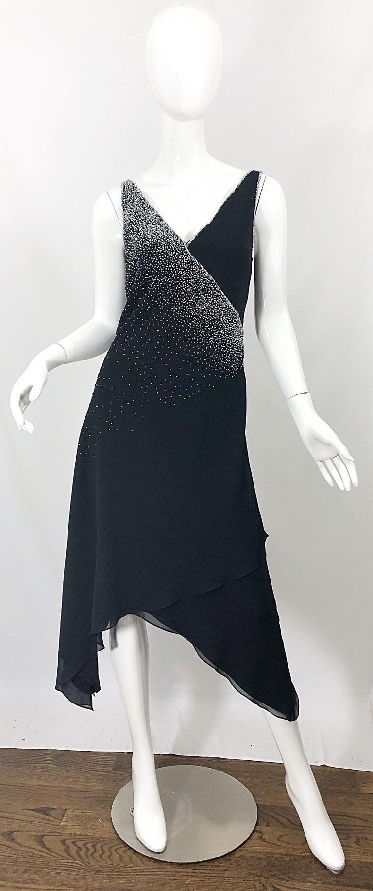 Beautiful vintage 90s BOB MACKIE black silk chiffon hi-lo dress! Hundreds of hand-sewn silver beads throughout. Hidden zipper up the back with hook-and-eye closure. The perfect timeless black dress that offers so much style. Very well made, with