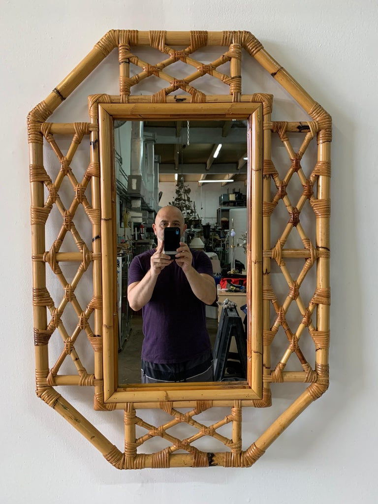 This vintage bamboo Chippendale or Bohemian styled accent mirror in octagonal shape, is sturdy and very well constructed; Chic and very desirable!