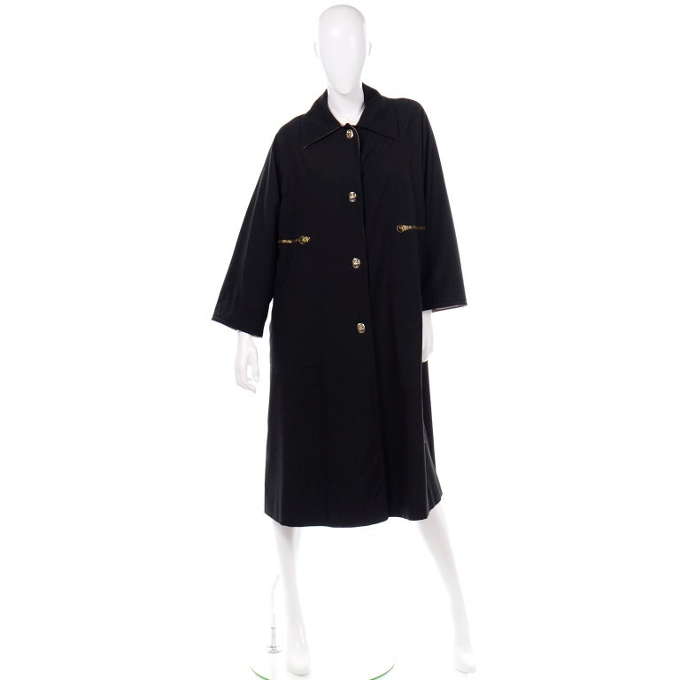 We love vintage Bonnie Cashin clothing and we have sold hundreds of her pieces over the years. Her raincoats always stand the test of time, and this vintage Bonnie Cashin coat would be such a great one to add to your wardrobe! This great black coat
