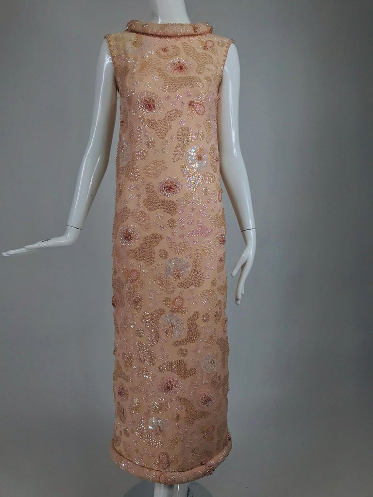 Vintage Bonwit Teller Pale Pink Beaded Sequin Demi Couture Gown from the 1960s. A style made famous by Jackie O in her early White House years. Gorgeous pale pink chiffon over satin, sleeveless A line gown with a stand away hand padded, rolled and