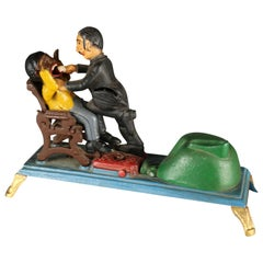 Vintage Book of Knowledge Cast Iron Mechanical Bank, The Dentist, 20th Century