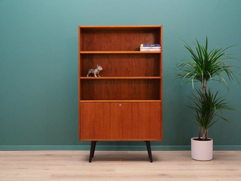 Fantastic bookcase from the 1960s-1970s. Scandinavian design, Minimalist form. Surface of the furniture finished with teak veneer. Bookcase has two shelves and a practical bar. Preserved in good condition (minor bruises and scratches) - directly for
