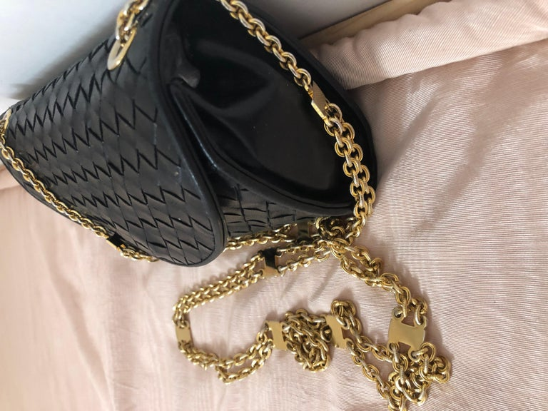 This beautifully crafted handbag will take you from morning to night, no need to change your purse. It is in excellent condition except for the lining (as pictured) which has started peeling in places. The leather is supple, the gold tone chain is