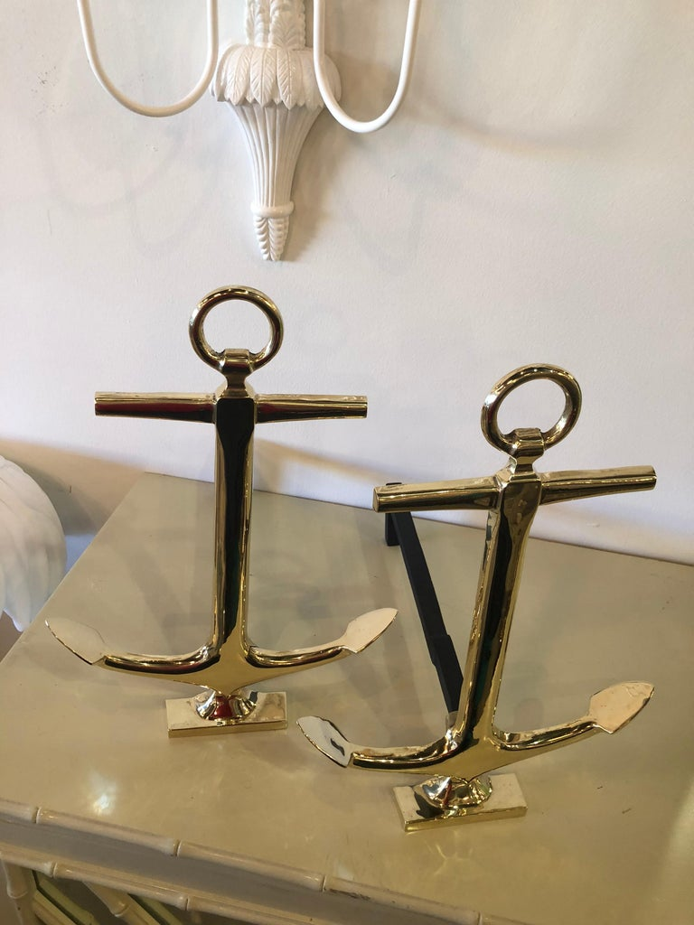 Professionally restored and polished brass anchor andirons, a pair.