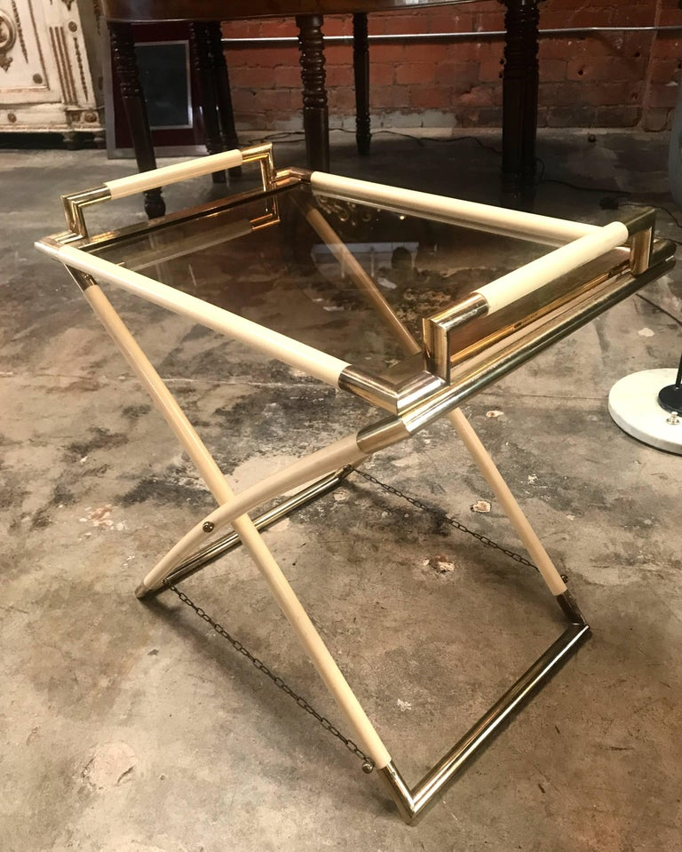 Vintage brass and glass cocktail table  (with the top that becomes a tray).