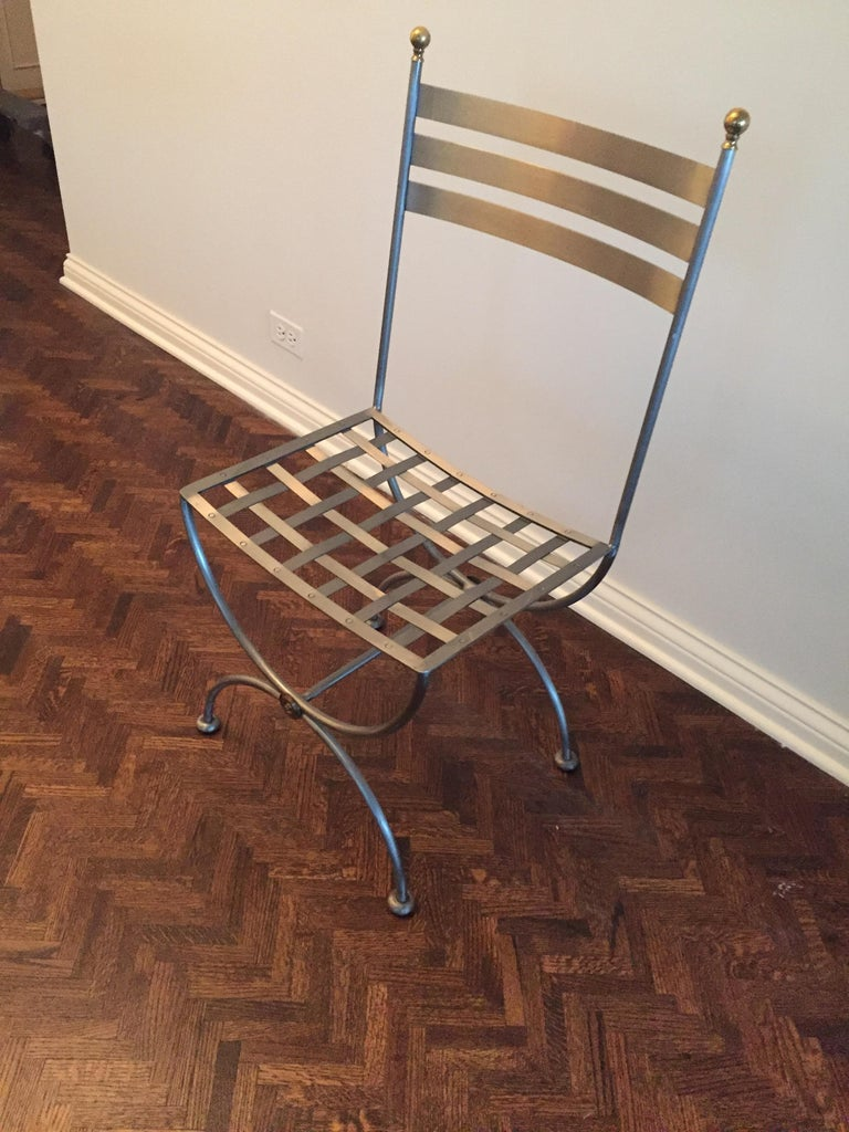 Vintage brass and iron Savonarola side chair Lovely accent to any room or sunroom. Brass and iron side chair, currently used with custom cushion as a kitchen office chair but will work anywhere! classic iconic perfect less.  Dimensions: 17