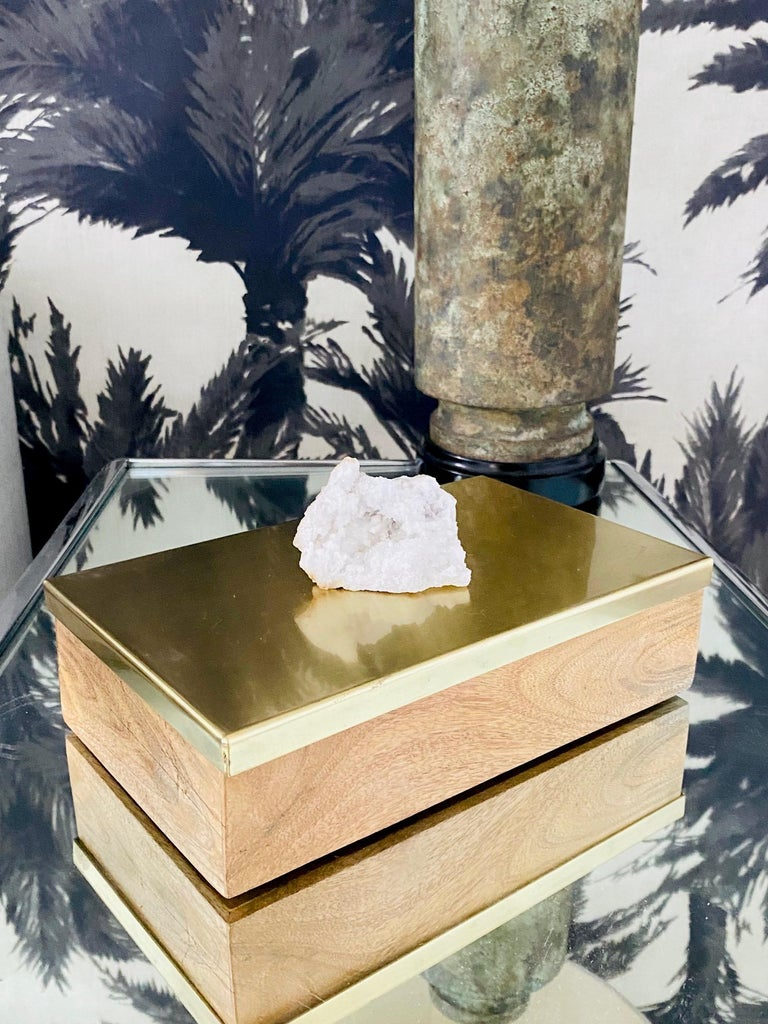 Vintage Hollywood Regency style decorative box in white oakwood with a satin brass metal lid. The box features a large white quartz crystal stone accent. The hinged lid opens to reveal a large interior for convenient storage. Makes a chic desk top