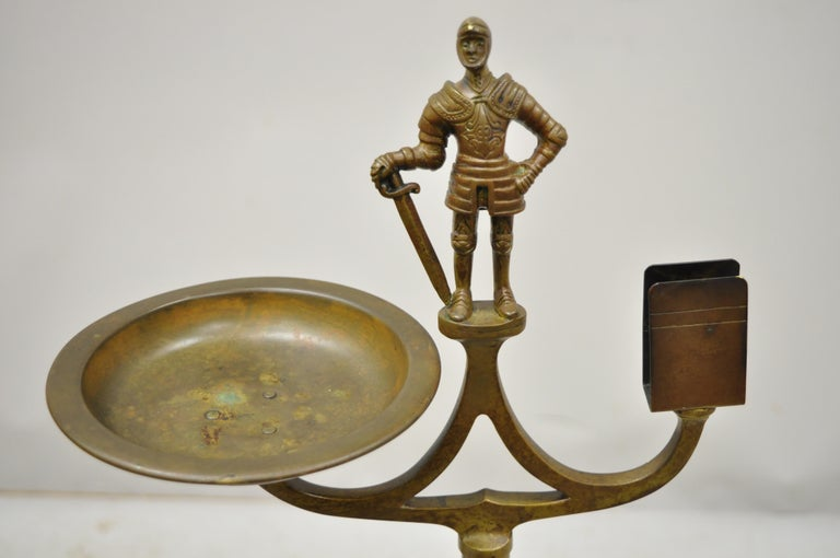 Vintage brass bronze medieval knight figural smoking stand ashtray spiral column, circa early 1900s. Measurements: 34