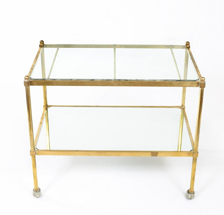 Stunning Italian two-tiered brass / glass / mirror bar cart. The top shelve is glass with the exception of the bottom shelve which is mirror shelve. The bar cart is in good vintage condition with wear appropriate to age / use. The cart measure about
