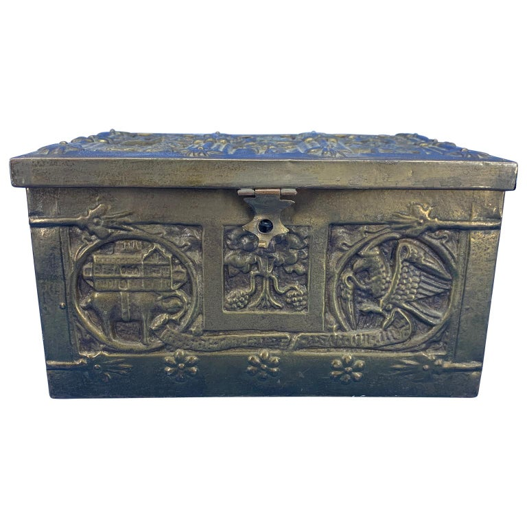 Vintage brass jewelry box with religious scenes The box has a wooden insert.