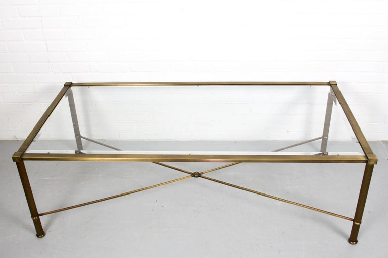 A very stylish and beautiful vintage side tables with glass top, this table date from the 1960s. The condition is great for its age, the metal is painted in brass-look and the glass shelve with facet edges has no chips or cracks.