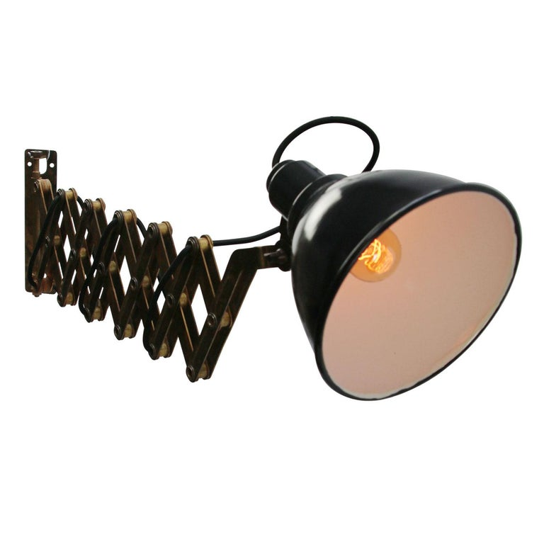 Brass scissor wall light. Enamel shade diameter: 18 cm. Maximum length: 100 cm. Minimum length: 40 cm. Wall plate: 22.5 × 6 cm.  Weight: 2.5 kg / 5.5 lb  Priced per individual item. All lamps have been made suitable by international standards