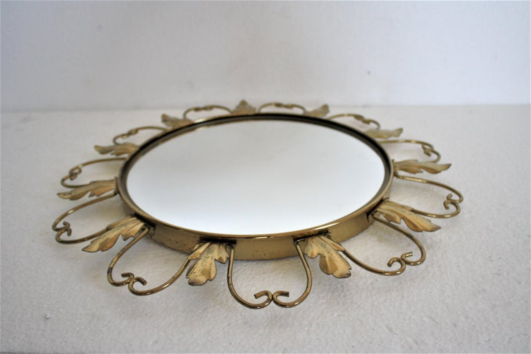 Midcentury brass sunburst or flower mirror with convex glass.