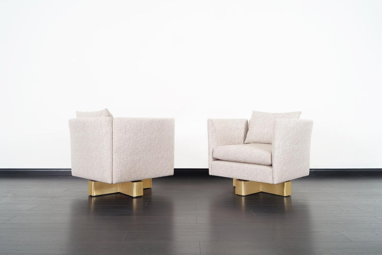 An exceptional pair of vintage swivel lounge chairs attributed to Milo Baughman. Manufactured by Hayes Furniture in Oakland, California. Each chair has a brass base that swivels with ease. The chairs are professionally reupholstered.
