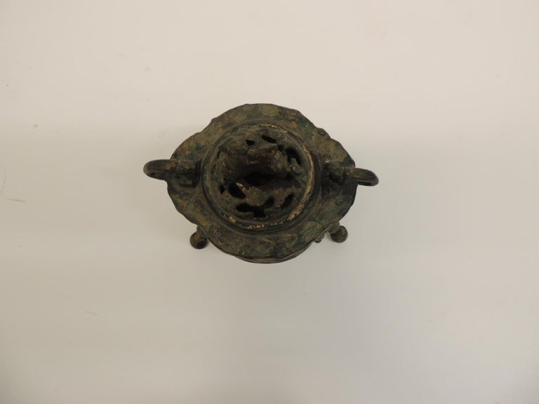 Vintage bronze Asian incense burner Bronze Asian vintage incense burner with an intricate pierced oval shape.  Vintage Asian incense burner topped with a foo-dog handle and a unique patina. 1920s, Asian Size: 7 x 5 x 7.