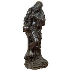 Vintage Bronze Sculpture Depicting a Mythical Warrior Holding a Flask