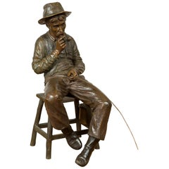 Vintage Bronze Sculpture of a Sitting Old Timer Smoking His Pipe and Fishing