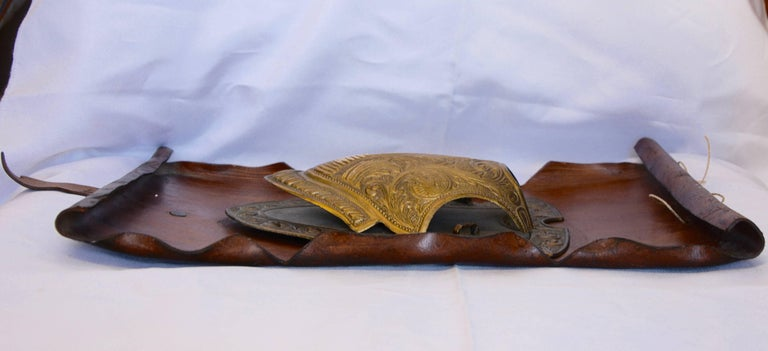 Vintage Bronze Shield on Rustic Leather Scroll Wall Hanging In Good Condition For Sale In Cookeville, TN