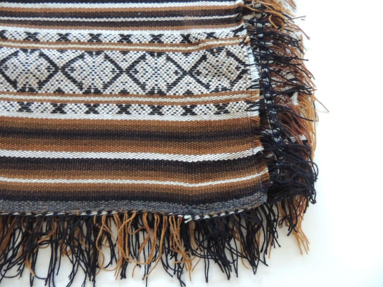 Vintagebrown and black stripe throw with fringes. Multi dark stripes with white and brown fringes. Size: 42