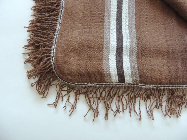 Vintage brown and tan stripe woven throw with fringes. Light and dark stripes makes this throw unique. 2
