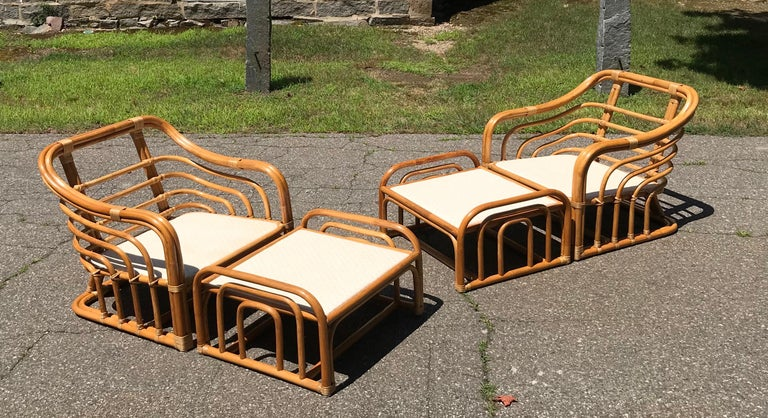 Vintage brown Jordan rattan lounge chairs with ottomans. Chairs measure 30