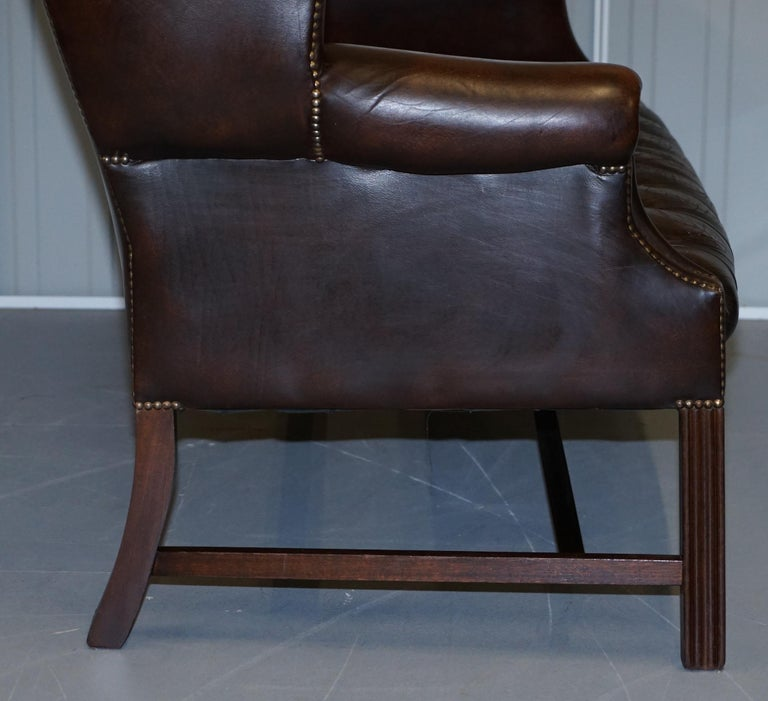 Vintage Brown Leather Chesterfield Fully Tufted Wingback Two Seat Sofa Armchair For Sale 9