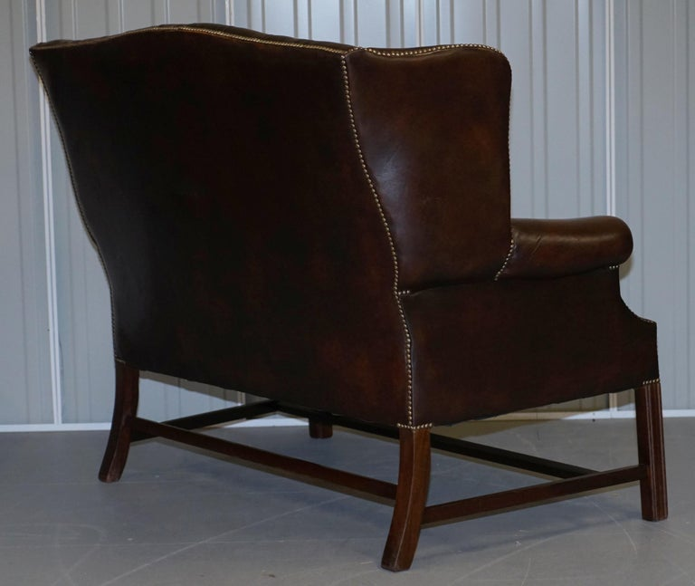 Vintage Brown Leather Chesterfield Fully Tufted Wingback Two Seat Sofa Armchair For Sale 10