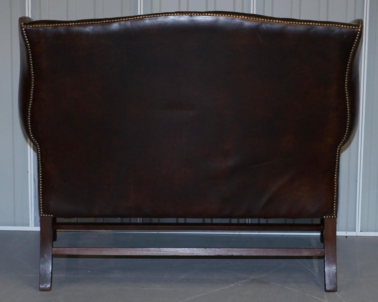 Vintage Brown Leather Chesterfield Fully Tufted Wingback Two Seat Sofa Armchair For Sale 11