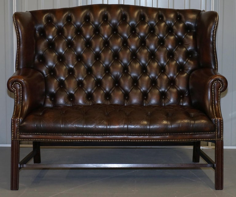 Wimbledon-Furniture  Wimbledon-Furniture is delighted to offer for sale this absolutely stunning original vintage fully buttoned aged brown leather chesterfield wingback sofa  Please note the delivery fee listed is just a guide, it covers within