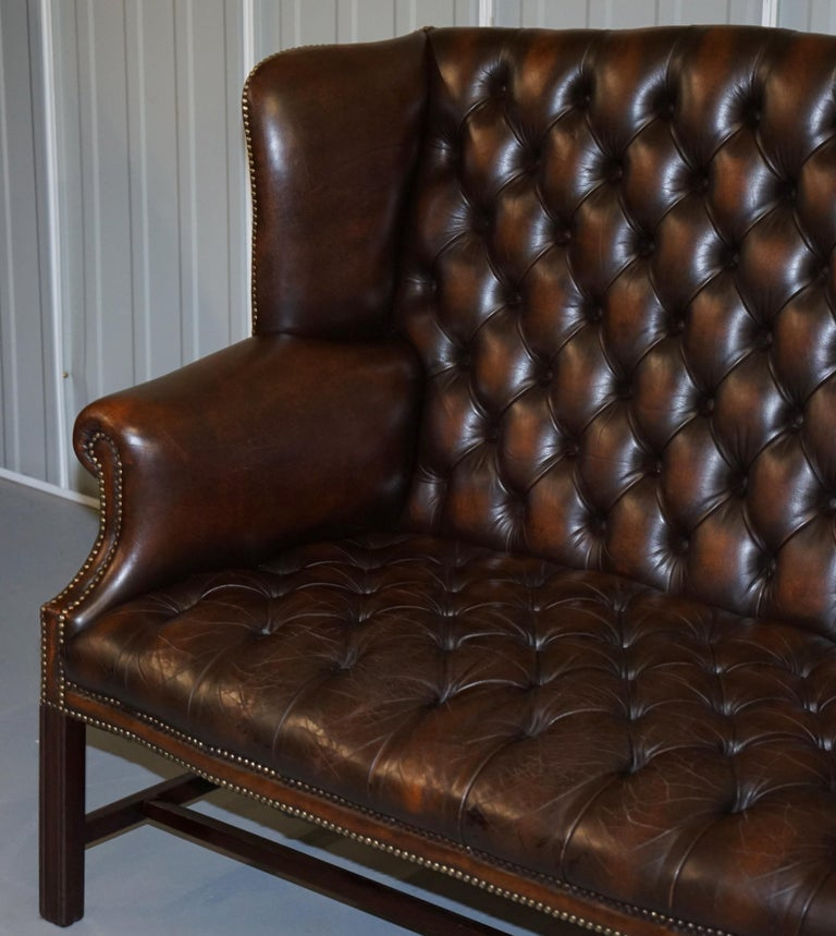 Hand-Crafted Vintage Brown Leather Chesterfield Fully Tufted Wingback Two Seat Sofa Armchair For Sale