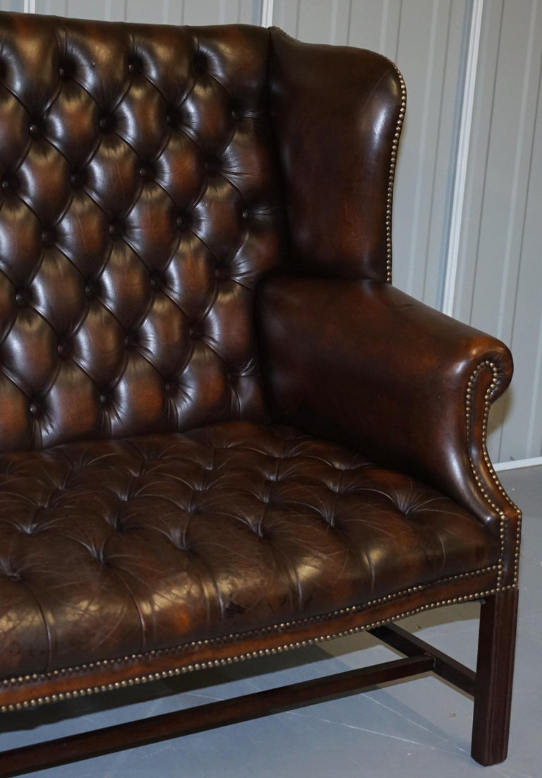 Vintage Brown Leather Chesterfield Fully Tufted Wingback Two Seat Sofa Armchair In Good Condition For Sale In London, GB