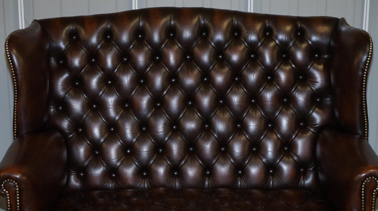 20th Century Vintage Brown Leather Chesterfield Fully Tufted Wingback Two Seat Sofa Armchair For Sale