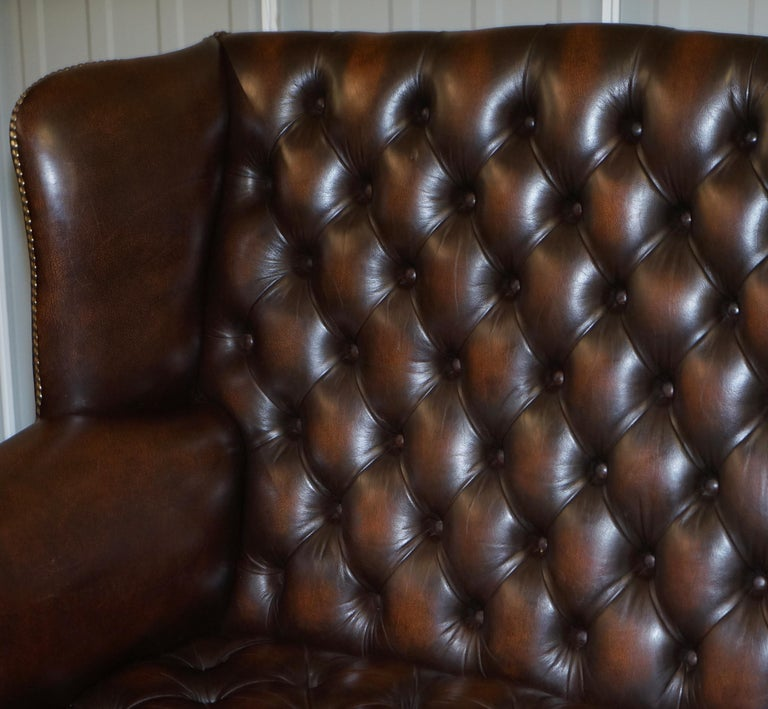 Vintage Brown Leather Chesterfield Fully Tufted Wingback Two Seat Sofa Armchair For Sale 1