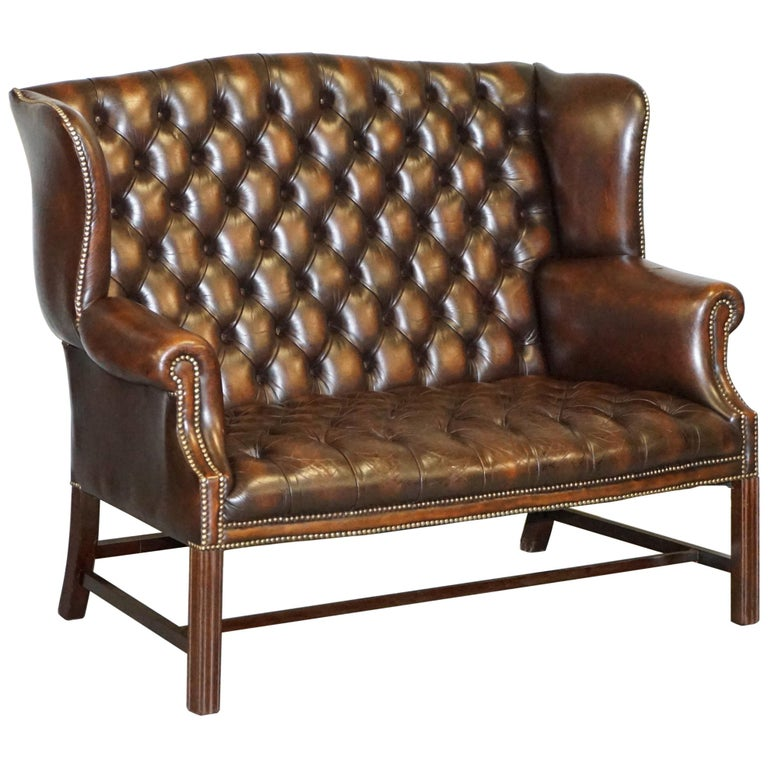 Vintage Brown Leather Chesterfield Fully Tufted Wingback Two Seat Sofa Armchair For Sale