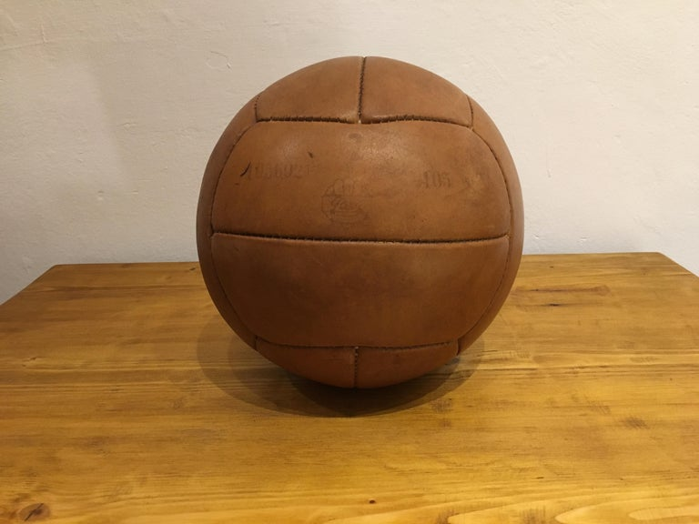 This medicine ball comes from the stock of an old Czech gymnasium. Made in the 1930s. Patina consistent with age and use. Cleaned and treated with a special leather care. Weight: 2kg. Measures: Diameter 9.4 inch.