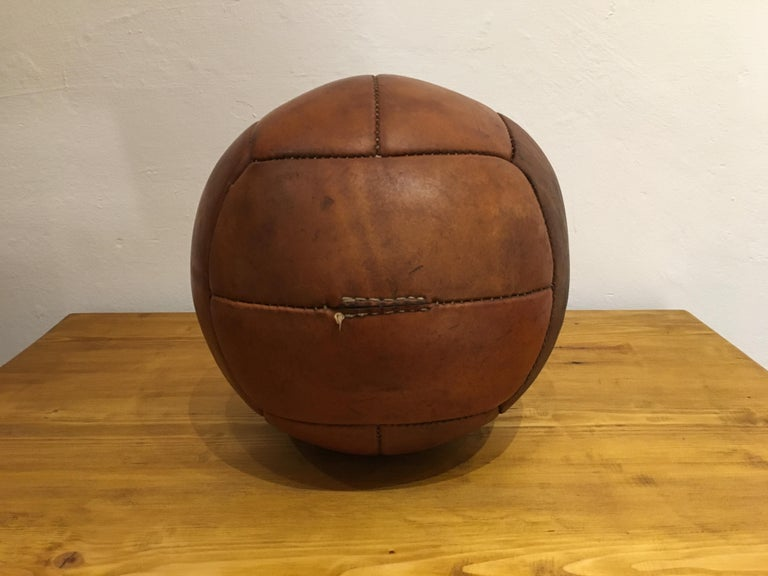 This medicine ball comes from the stock of an old Czech gymnasium. Made in the 1930s. Patina consistent with age and use. Cleaned and treated with a special leather care. Weight: 3kg. Measures: Diameter 10.2 inch.