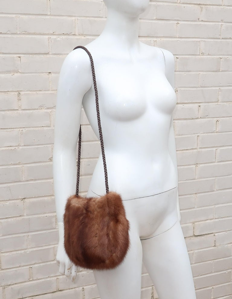 From one generation to the next!  This sumptuous brown mink handbag with a braided silk cord shoulder strap, snap closure and silk jacquard lining was repurposed by an Atlanta furrier C.1990 from a classic 1950's stole.  It would be perfect paired